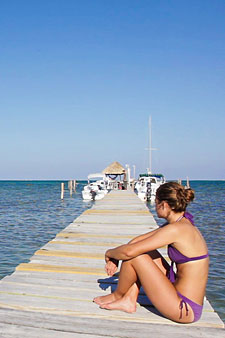 sitting on dock at Caye Caulker